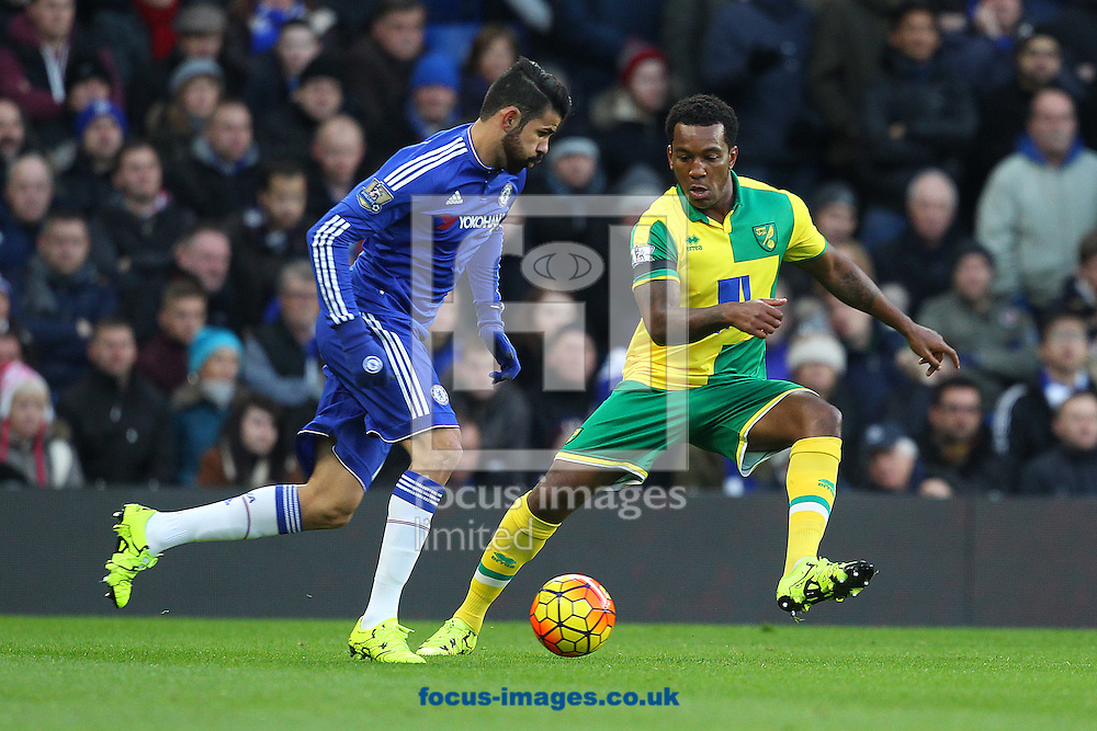 Diego Costa of Chelsea and Andre Wisdom of Norwich in action during the Barclays Premier League match at Stamford Bridge, London<br /> Picture by Paul Chesterton/Focus Images Ltd +44 7904 640267<br /> 21/11/2015