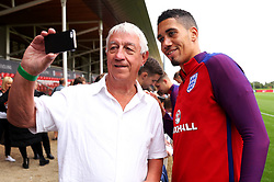 England's Chris Smalling poses for pictures with fans - Mandatory by-line: Matt McNulty/JMP - 29/08/2017 - FOOTBALL - St George's Park National Football Centre - Burton-upon-Trent, England - England Training and Press Conference