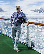 Tom Dempsey views sea ice in the Southern Ocean offshore from tidewater glaciers on Graham Land, the north part of the Antarctic Peninsula, in Antarctica. For licensing options, please inquire.