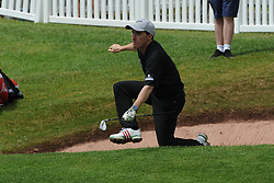 © Licensed to London News Pictures. 01/07/2017. London, UK, Comedian and tv presenter Rob Brydon trips up after ending up in a sand bunker during The 2017 Celebrity Cup golf tournament at the Celtic Manor Resort, Newport, South Wales. Photo credit: Jeff Thomas/LNP