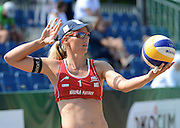 STARE JABLONKI POLAND - July 3: Barbara Hansel /1/ of Austria in action during Day 3 of the FIVB Beach Volleyball World Championships on July 3, 2013 in Stare Jablonki Poland.  (Photo by Piotr Hawalej)