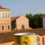 coffee cup and saucer on hotel balcony railing, Venice, Italy<br />