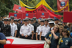 © Licensed to London News Pictures. 06/09/2014. Parade by 1000 crew members from the regatta. The biggest tall shop event on the Thames has continued across the weekend. Up to a million people are expected to visit Greenwich during the course of the Royal Greenwich Tall Ships Festival which has brought 50 vessels to the capital. Credit : Rob Powell/LNP
