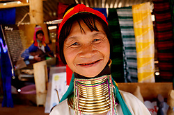A Padaung woman with brass rings around her neck smiles as she stands at her gift shop in Panpet Village, Demoso Township, Kayah State, Myanmar, April 11, 2016. The brass rings are first applied when the Padaung girls are about eight years old and as the girl grows older, longer coils are added up to 24 or 25 rings. EXPA Pictures © 2016, PhotoCredit: EXPA/ Photoshot/ U Aung<br /> <br /> *****ATTENTION - for AUT, SLO, CRO, SRB, BIH, MAZ, SUI only*****