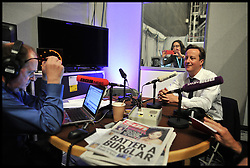 David Cameron during a radio interview with James Naughtie for BBC News during the Conservative Party Conference at ICC, Birmingham, on the second day of the Party Conference, Tuesday October 9, 2012. Birmingham, England. Photo by Andrew Parsons / i-Images..
