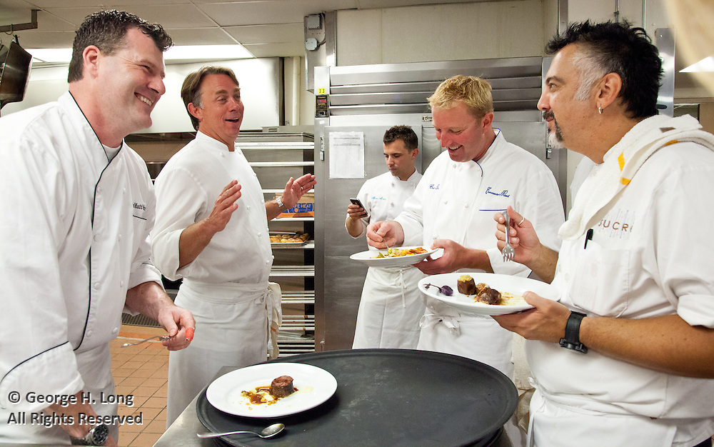 Chefs Matt Murphy, John Besh, Tory McPhail, and Tariq Hanna cooking in the kitchen at the JW Marriott during the Ella Brennan Lifetime Achievement in Hospitality Award Dinner honoring Chef Paul Prudhomme; New Orleans Wine & Food Experience