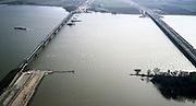 Nederland, Hollandsch Diep, 08-03-2002; in ZZO richting met Moerdijkbruggen, links van de vakwerk spoorbrug de Nieuwe Merwede, rechts de brug voor het wegverkeer (A16); HSL komt rechts van  bestaande spoorbrug te lopen, zand voor spoordijk reeds aanwezig (linksonder), bouw pijlers in het water; infrastructuur verkeer en vervoer spoor mobiliteit transport rivier binnenvaart landschap;<br /> luchtfoto (toeslag), aerial photo (additional fee)<br /> foto /photo Siebe Swart