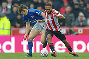 Leicester City defender Çaglar Söyüncü (4) battles for possession Brentford forward Bryan Mbeumo (19) during The FA Cup match between Brentford and Leicester City at Griffin Park, London, England on 25 January 2020.