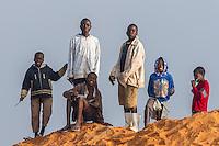 Young Mozambican  boys posing on a sand heap, Limpopo floodplain, Maputo Province, Mozambique
