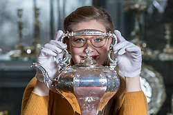 The Bonham's Home &amp; Interiors Sale takes place on 21-22 February and features  a wide array of silver and porcelain.<br /> <br /> Pictured: Jaine Heggie of Bonhams with a rococo revival tea kettle and stand
