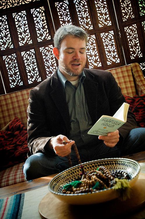 Muslim convert Yahya Birt (son of ex Director General of the BBC, John Birt), reading the Quran, Leicester, England, UK.