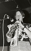 808 State member playing the clarinet, Manchester, 1989.