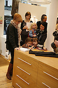 Patsy Palmer and Charlotte Cutler (  Etta Cutler )., Amelie Palmer, Mercy Magic. Comptoir des Cotonniers shop opening. Westbourne Grove. London. 25 October 2006. -DO NOT ARCHIVE-© Copyright Photograph by Dafydd Jones 66 Stockwell Park Rd. London SW9 0DA Tel 020 7733 0108 www.dafjones.com