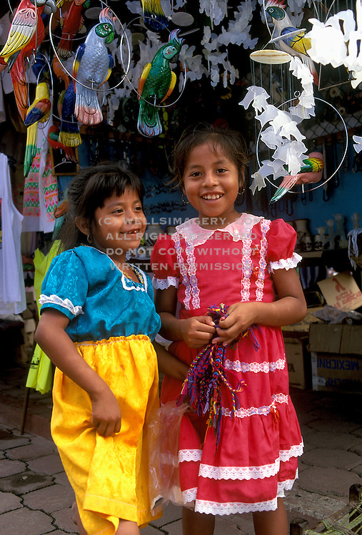 Image of a children smiling in Zihuatenejo, Mexico