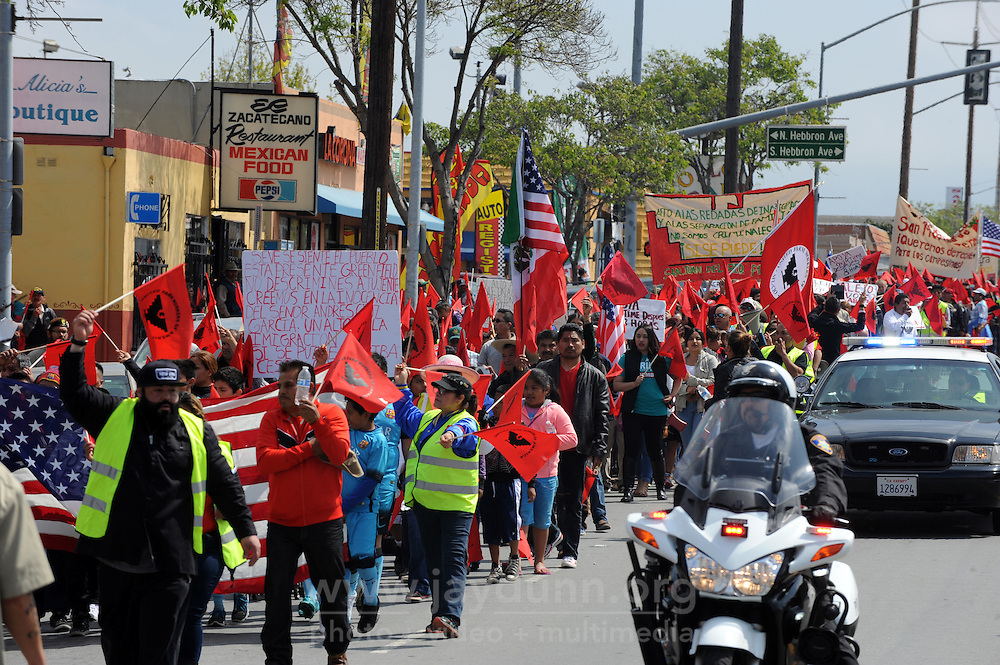 "With cries of ""Si Se Puede"" ringing out in a sea of red United Farm Worker flags, hundreds of people joined forces in east Salinas on Sunday morning to help rejuvenate the annual march honoring labor leader César Chávez."