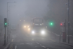 © Licensed to London News Pictures. 09/11/2019. London, UK. Traffic struggles through thick fog on a freezing morning on The Chamberlayne Road in Kensal Rise, north west London. Large parts of the North of England have suffered heavy flooding following torrential rain. Photo credit: Ben Cawthra/LNP