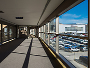 """13 MARCH 2020 - DES MOINES, IOWA: An empty skywalk in downtown Des Moines. Downtown Des Moines is nearly deserted as many of employers are implementing work at home rules. The Governor of Iowa announced Friday that 17 people in Iowa have tested positive for the Novel Coronavirus. Of those, 15 people were exposed on the same cruise in Egypt, the others were exposed through travel but were not on the same cruise. The Governor said there has not yet been any """"community spread"""" in Iowa. All of the Iowans who have tested positive are in self quarantine. Across Iowa, municipalities and businesses are taking steps to implement """"social distancing."""" Most of the colleges in Iowa have announced that they will remain closed after their spring breaks and that classes will move to online only, after spring break. Many businesses in Des Moines, including Nationwide Insurance and EMC Insurance, have announced plans to have their employees to telecommute. The mayor of Des Moines has urged event planners to consider canceling large events.     PHOTO BY JACK KURTZ"""