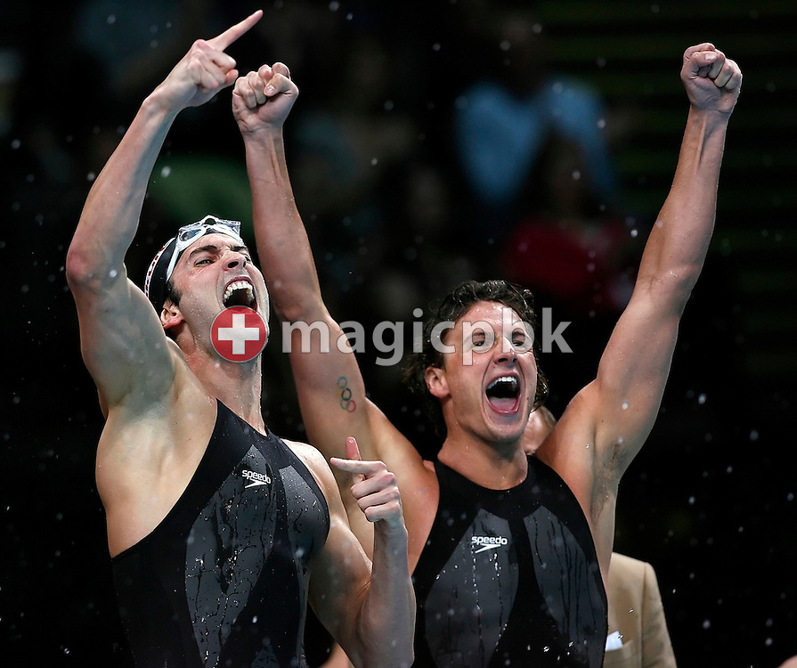 (L-R) Bryan LUNDQUIST and  Ryan LOCHTE of the USA jubilate after their teammate, who swam the last leg, clocked first in a new world record time in men's 4x100m freestyle relay final in the Duncan Goodhew pool at the FINA Swimming World Championships (25m) in Manchester, Great Britain, Wednesday, April 9, 2008. (Photo by Patrick B. Kraemer / MAGICPBK)