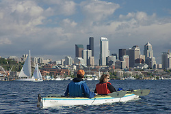 North America, United States, Washington, Seattle, couple kayaking on Lake Union near Space Needle and downtown Seattle  MR