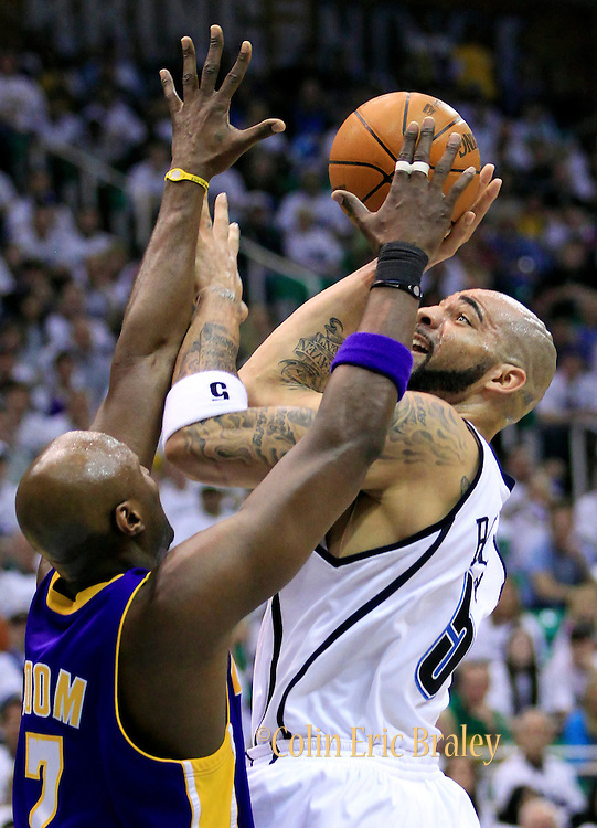 Utah Jazz forward Carlos Boozer, right shoots over Los Angeles Lakers forward Lamar Odom, left, during the first half of Game 3 of the NBA Western Conference second-round playoff series in Salt Lake City, Saturday, May 8, 2010. (AP Photo/Colin E Braley)