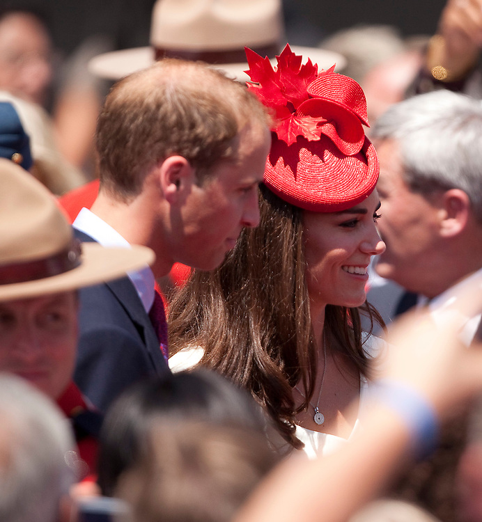 Britain's Prince William and his wife Catherine the Duchess of Cambridge greet well wishers following  Canada Day celebrations on Parliament Hill in Ottawa, Canada, July 1, 2011. The duke and Duchess are on a nine day tour of Canada, their first official foreign trip as husband and wife.<br /> AFP PHOTO/GEOFF ROBINS