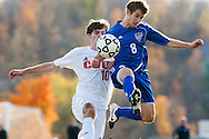 Mt. Anthony's Trey Lang (8) leaps in front of CVU's Cooper O'Connell (10) to play the ball during the boys semifinal soccer game between Mount Anthony and Champlain Valley Union at CVU high school on Tuesday afternoon October 27, 2015 in Hinesburg. (BRIAN JENKINS/ for the FREE PRESS)