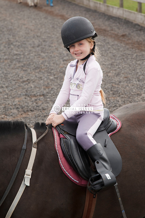 Girl at riding lesson.