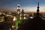 Egypt . Cairo : Qalawun complex. minarets of An Nasr  and Qalawun in the old islamic city,  . in Al Mu'izz street .  view from the minaret of the madrasa of As Zahir BARQUQ  mosque Cairo - Egypt