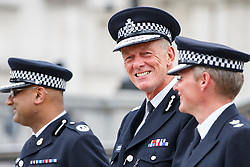 © Licensed to London News Pictures. 03/08/2015. London, UK. Metropolitan Police Commissioner Bernard Hogan-Howe attend a parade for the capital's young police volunteers in Trafalgar Square, London on Monday, August 3, 2015. Photo credit: Tolga Akmen/LNP