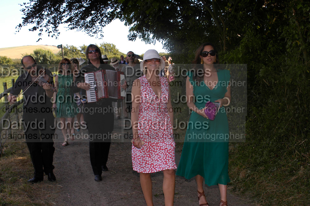 Jessica de Rothschild. Marriage of Emilia Fox to Jared Harris. St. Michael's and All Angels. Steeple. Nr. Wareham. Dorset. 16 July 2005. ONE TIME USE ONLY - DO NOT ARCHIVE  © Copyright Photograph by Dafydd Jones 66 Stockwell Park Rd. London SW9 0DA Tel 020 7733 0108 www.dafjones.com