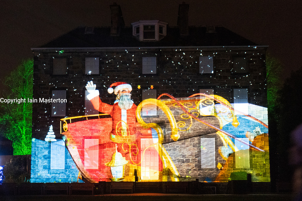Edinburgh, Scotland, UK. 23 November, 2018. Christmas at the Botanics opens at the Royal Botanic Garden Edinburgh. The annual night event features an illuminated trail through the gardens with over a million lights. Pictured, Dear Santa animation. Projection on facade of Inverleith House. Designed by Ross Ashton.