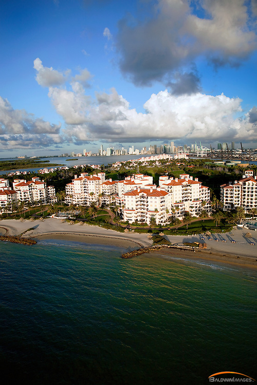 Fisher Island in the early morning light with Miami skyline in the background, aerial view