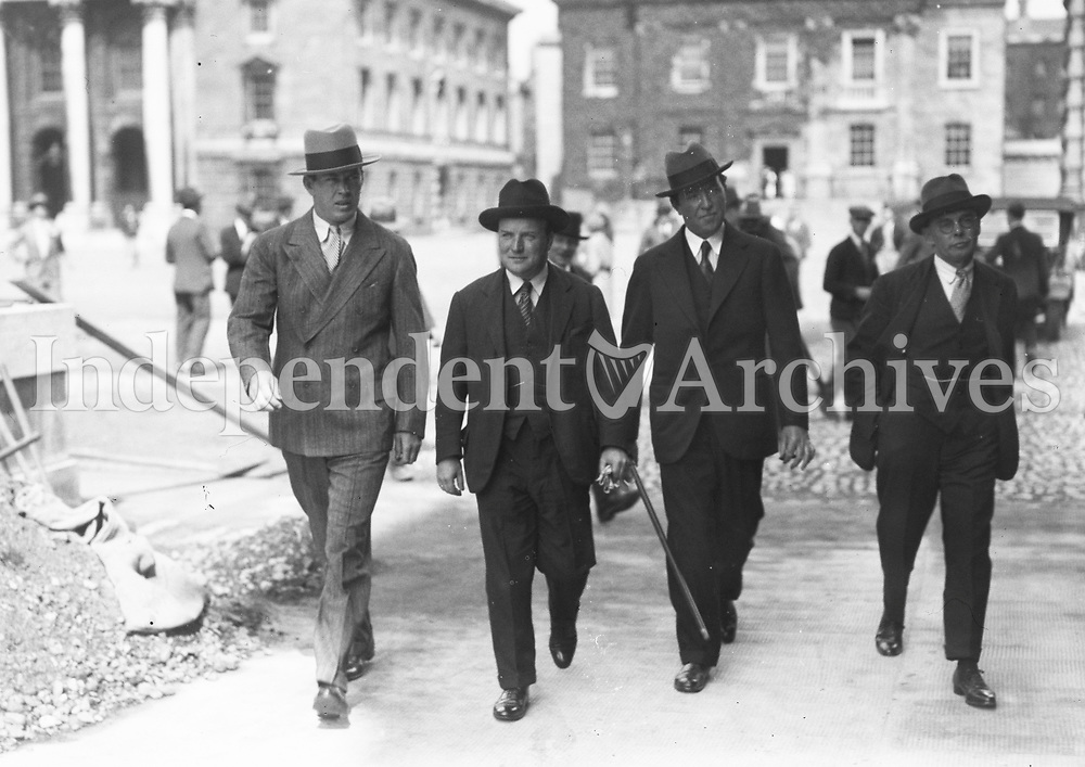 H935 Boxer Gene Tunney Training in Dublin. Walking with group around Trinity College, Dublin. August 1928. (Part of the Independent Newspapers Ireland/NLI Collection)