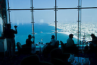 Tourists and diners enjoy the view from the top of the Burj al Arab hotel. Dubai, one of the seven emirates and the most populous of the United Arab Emirates sits on the southern coast of the Persian gulf.