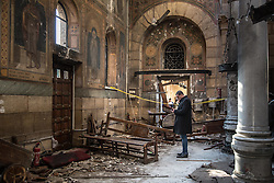 December 11, 2016 - Cairo, Egypt - An official surveys the damage of an explosion inside the Coptic Cathedral in Cairo, Egypt, December 11, 2016 (Credit Image: © Sima Diab via ZUMA Wire)