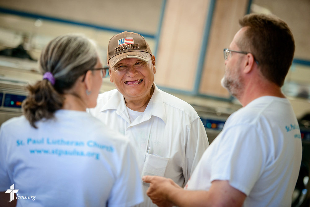 "Roxanne and Ross Johnson, volunteers from St. Paul Lutheran Church, San Antonio, Texas, chat with Ray during the Laundry Love event on Wednesday, Aug. 2, 2017, at the E-Z Wash laundromat in San Antonio. The monthly ministry event is supported by a grant through the ""Stand With Your Community"" program, which was made possible by a partnership between the LCMS, Thrivent Financial and Lutheran Church Extension Fund. LCMS Communications/Erik M. Lunsford"
