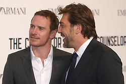 Spanish actor Javier Bardem, right, and German actor Michael Fassbender share a joke as they arrive in London's Leicester Square for a special screening of The Counselor, in  London,  Thursday, 3rd October 2013. Picture by Max Nash / i-Images