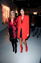 Left to right, Carine Roitfeld and Giovanna Battaglia at a private view of Nicolas Pol's paintings entitled 'Mother of Pouacrus' held at The Dairy, Wakefield Street, London WC1 on 14th October 2010.