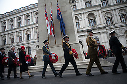 The Anzac Day tradition -WW1 memorial. Representatives of the  Arm forces and ex-service organisations   hold wreaths during the ANZAC day at The Centotaph in a service of remembrance. Whitehall, London, United Kingdom. Friday, 25th April 2014. Picture by Daniel Leal-Olivas / i-Images