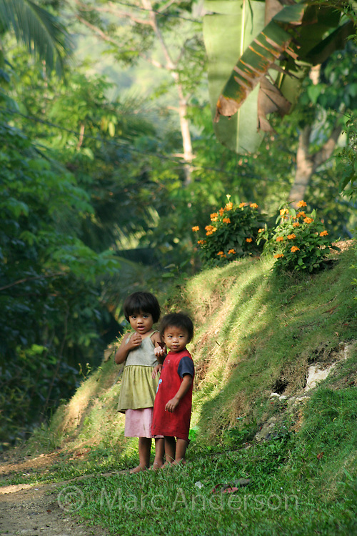 Two little children on a path, Bohol, Philippines..