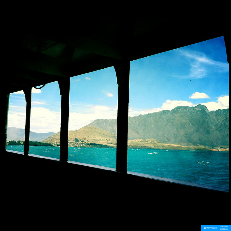 The Remarkables mountain range viewed from the TSS Earnslaw, the 100 year old vintage coal fired passenger steam ship which sails on Lake Wakatipu, Queenstown, New Zealand. The popular tourist attraction is celebrating it's centenary year with celebrations planned for October 2012.  Queenstown, Central Otago, New Zealand. 29th February 2012. Photo Tim Clayton