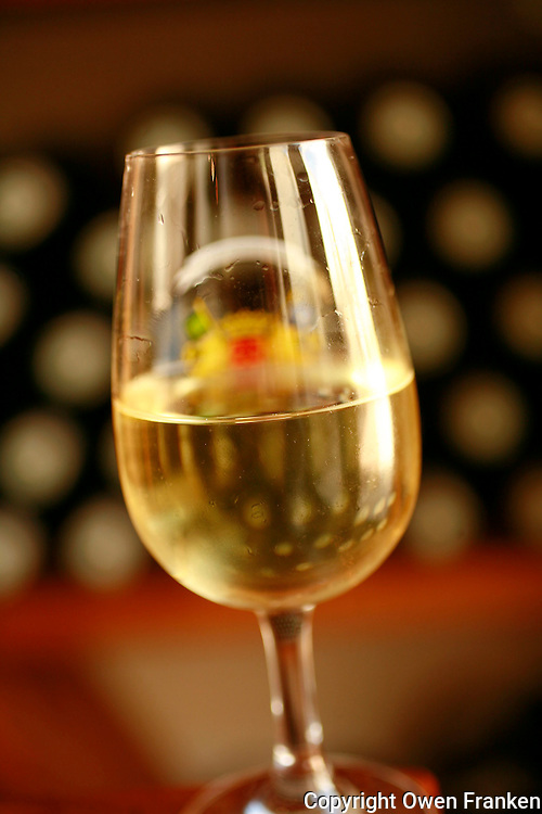 .a glass of Grand Cru Chardonnay in the municipal tasting and selling Caveau of Chassagne Montrachet, in the Cote de Beaune part of Burgundy...Photo by Owen Franken for the NY Times..May 28, 2008.