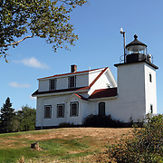 Fort Point Lighthouse in Fort Point Light State Park, Maine, USA. The lighthouse is on Penobscot Bay.