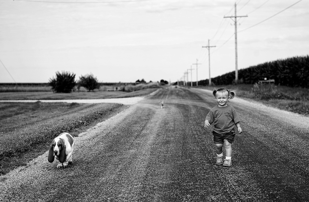 Laura Poeppel walks with her dog on the road near her family's organic farm near Wyoming. ©David Zalaznik