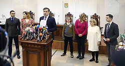 January 3, 2018 - Kyiv, Ukraine - Rukh Novykh Syl (Movement of New Forces) Party leader, former Odesa Regional State Administration head Mikheil Saakashvili (front) briefs the press in the presence of his lawyer Ruslan Chornolutskyi (L), his wife Sandra Roelofs (3rd R) and their son Nikoloz (4th R) after the Kyiv Court of Appeal postponed a hearing till January 11, Kyiv, capital of Ukraine, January 3, 2018. Ukrinform...KYIV. The Kyiv Court of Appeal has postponed a hearing into the case of Rukh Novykh Syl (Movement of New Forces) Party leader, former Odesa Regional State Administration head Mikheil Saakashvili till January 11. The Prosecutor General's Office filed an appeal after the court of the first instance declined a two-months' house arrest for Mikheil Saakashvili. (Credit Image: © Volodymyr Tarasov/Ukrinform via ZUMA Wire)