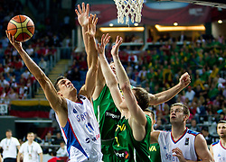 Marko Keselj of Serbia vs Martynas Pocius of Lithuania during the third-place basketball match between National teams of Serbia and Lithuania at 2010 FIBA World Championships on September 12, 2010 at the Sinan Erdem Dome in Istanbul, Turkey. Lithuania defeated Serbia 99 - 88 and win placed third.  (Photo By Vid Ponikvar / Sportida.com)