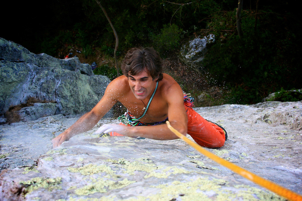 Nuno soares in the final moves of a trad climbing route in Penacova, Portugal.