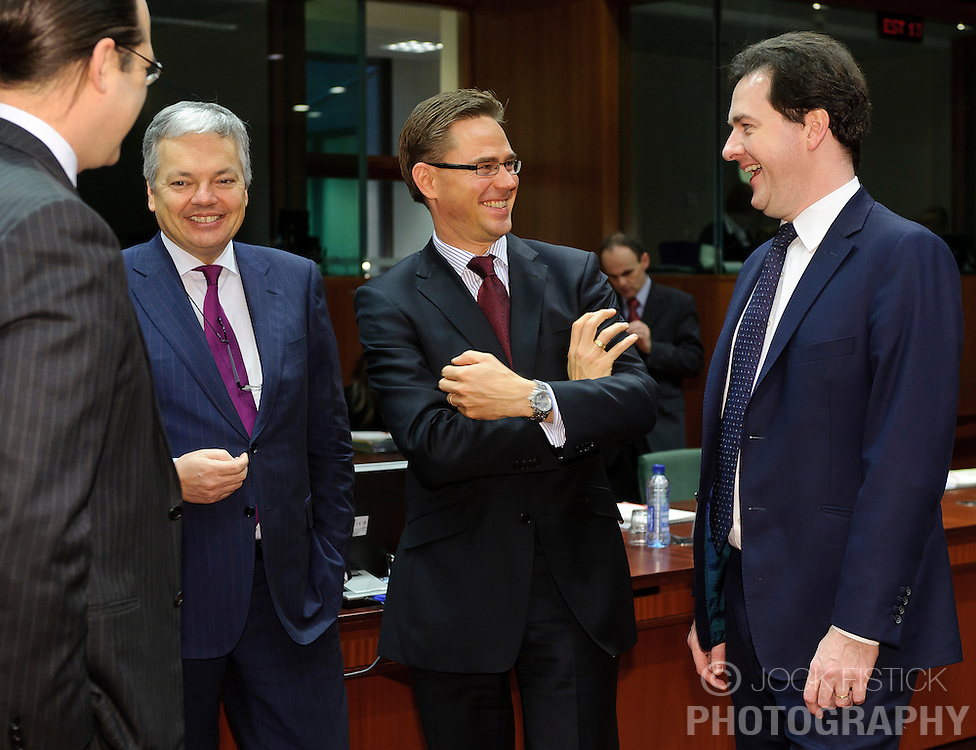 Jyrki Katainen, Finland's finance minister, center, shares a laugh with George Osborne, the UK's chancellor of the exchequer, right, Anders Borg, Sweden's finance minister, left, and Didier Reynders, Belgium's finance minister, center left, during a meeting of EU finance ministers, at the European Council headquarters, in Brussels, Tuesday, Dec. 7, 2010.(Photo © Jock Fistick).