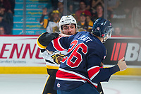 REGINA, SK - MAY 25: Justin Lemcke #5 of Hamilton Bulldogs drops the gloves with Bryce Platt #26 of Regina Pats at the Brandt Centre on May 25, 2018 in Regina, Canada. (Photo by Marissa Baecker/CHL Images)