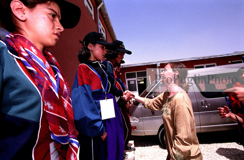 Female athletes receive their award for the 10 meters run competition at Bagh-e-Zanana...On 23-25 August 2005, Special Olympics Afghanistan held its first national Games at Olympic Stadium in Kabul. More than 300 athletes, including 80 female athletes, experienced a taste of happiness and achievement for the first time in their lives. They competed in athletics, bocce and football (soccer). Because of cultural restrictions, males and females competed at separate venues.